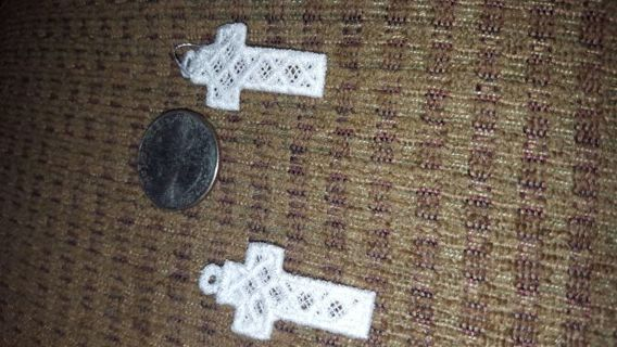 2 white embroidery crosses