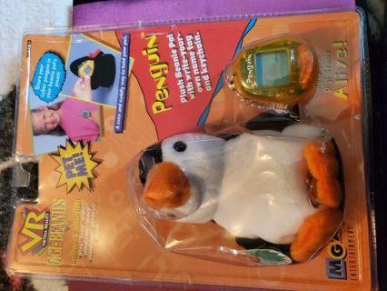 Penguin Digital pet with bonus penguin carrier.