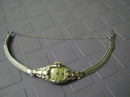 Solid 14k gold antique watch encrusted in genuine diamonds