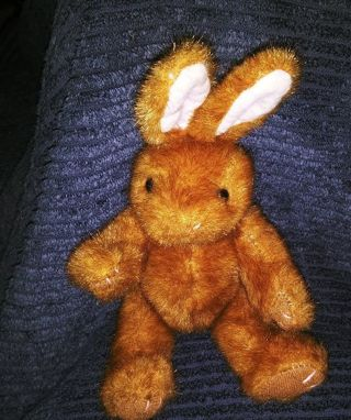Little stuffed brown bunny with moveable arms and legs. So cute.