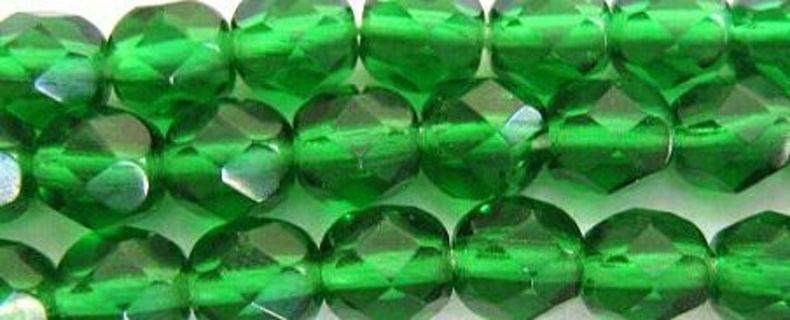 8 emerald green glass beads