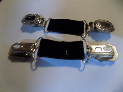 Pair of black enamel and silverplate sweater clips