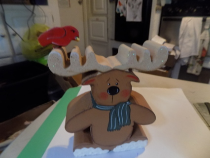 hand cut out wooden reindeer with red bird on his antlers
