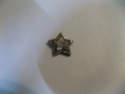 Silvertone star charm star rhinestone covered middle with another hammered dot star