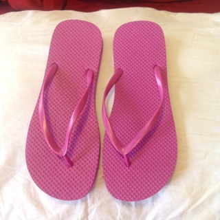 NWOT purple flip flops