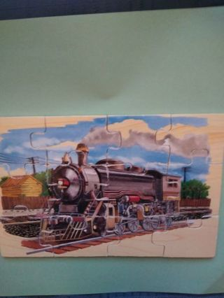 12 PIECE WOODEN LOCOMOTIVE JIGSAW PUZZLE BY MELISSA & DOUG (USED)