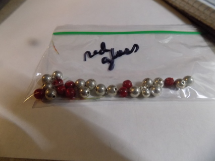 small bag glass red cats eye beads & silver plastic ones