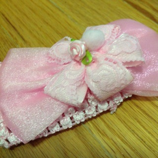 Children's Crocheted Pink Headband With Flower in the Center.