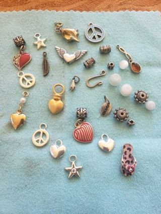 16 charms & 11 beads plus 2 findings