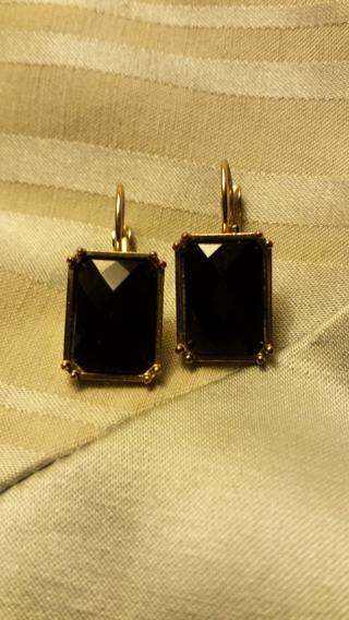 Black diamond-tucked cut clip earrings