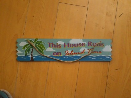 this house runs on island time wood sign