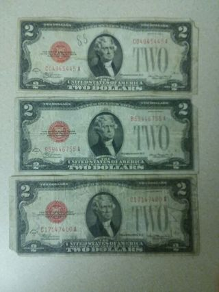 3 worn 1928 red seal 2 dollar bills