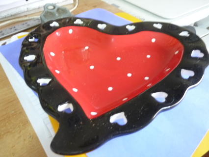 Ceramic heart shaped red, black candy dish with cut outs