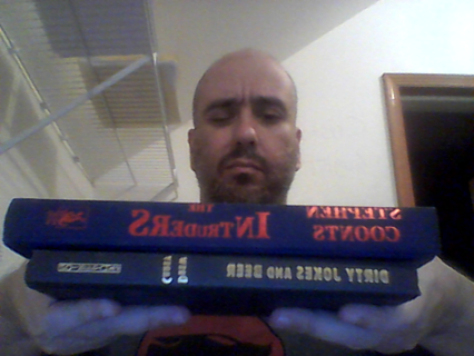 2 hardcover books without jackets.