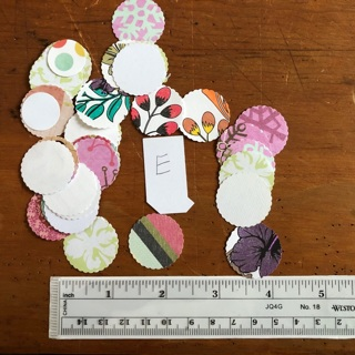 25+ punched circle tags - one size (E)