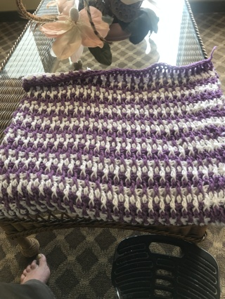 purple and white crocheted baby blanket