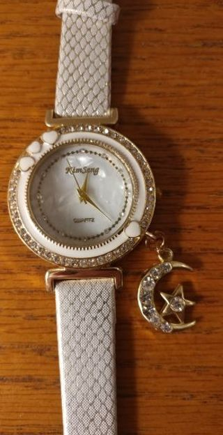 *FASHIONABLE WHITE WATCH with a moon & star charm! *FREE SHIPPING! **NO STARTING BID!!**