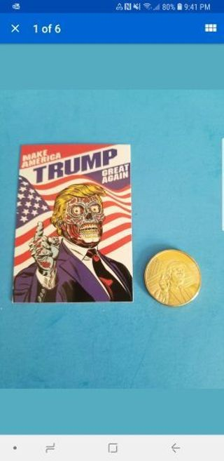 """TRUMP """"THEY LIVE"""" TWO-SIDED CARD AND GOLDPLATED COIN LOT."""