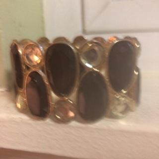 Black and gold bracelet .
