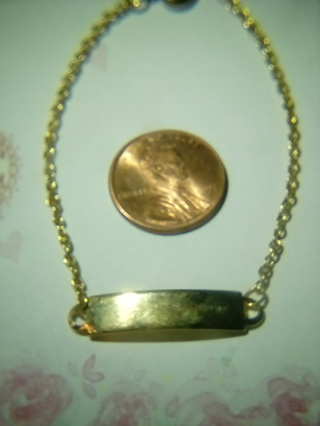 Gold tone metal bracelet