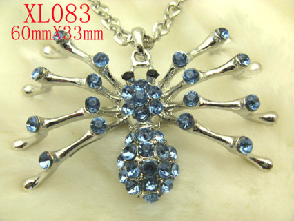 ALONG came a SPIDER blinged out spider necklace!!!! think HALLOWEEN !
