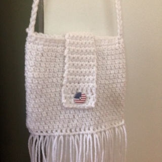 Beautiful Hand Crocheted Satchel. Flap over Closure and Cross Body Shoulder Strap .