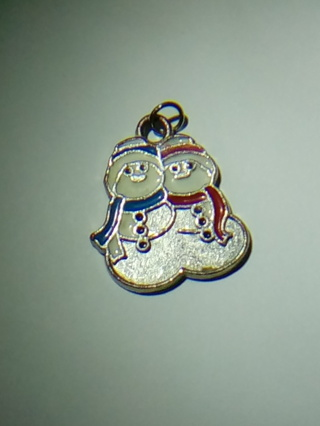 Snow Man couple charm in a red bag