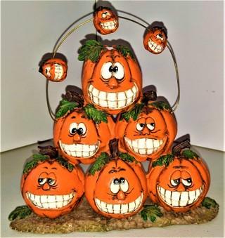 """Hard ceramic Halloween pumpkin decoration 7 1/2"""" high  X 8"""" wide - weight 15 oz. - VG condition"""