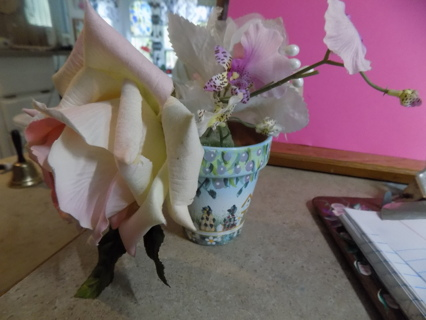 hand painted small clay flowerpot # 2 filled with pink roses and other flowers