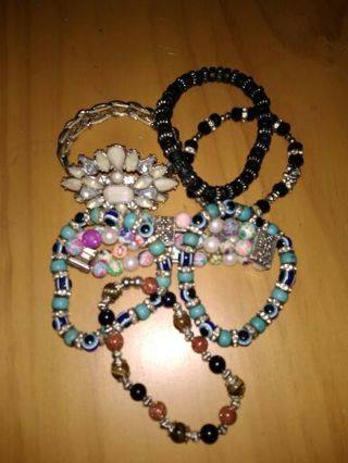 7 STRETCH BRACELETS/ HAVE 2 MANY/ SEE EACH PHOTO/WORN BUT EACH STILL HAVE A LOT OF TIGHTNESS.