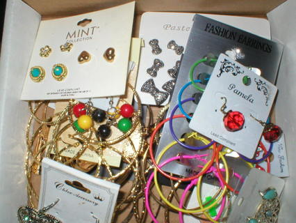 a box of 37 pairs of pieced earrings