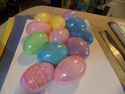 Set of 12 pearlescent plastic eggs to fill  one has a raised crown could be the prize egg
