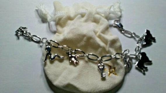Pamela Anderson charm bracelet silver logo pouch dog cat key crown whit gold NWT