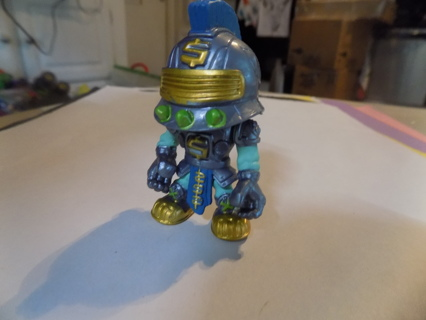 2 1/2 tall warrior in silver knight helmet with blue flume trim in gold