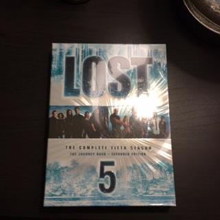 Lost season 5 DVDs set still shrink wrapped.
