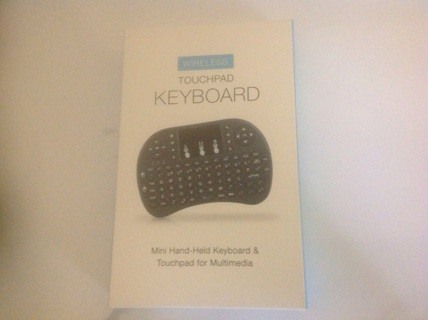 MINI HAND-HELD KEYBOARD & TOUCHPAD FOR MULTIMEDIA