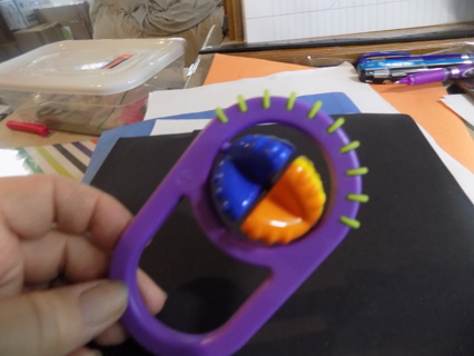 Purple baby rattler, turning x beads in center and textured rim to chew on
