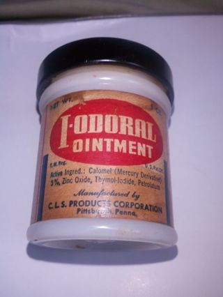 ANTIQUE. MILK GLASS JAR. WITH I-ODORAL OINTMENT LABLE ON IT. PITTSBURGH PA. (FOR THE COLLECTORS)