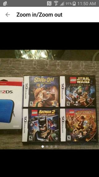 4 like new Nintendo DS Games & Carrying Case.