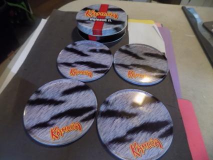 Kahlua tin with 4 metal striped coasters