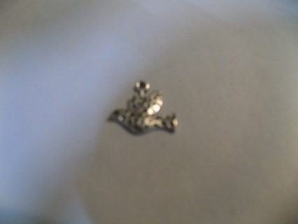 Silvertone hammered metal covered peace dove charm