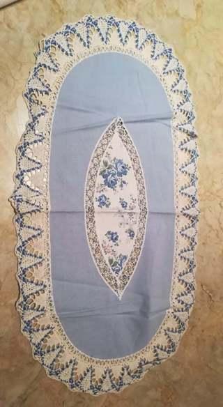 Hand-made oval doily light blue lace