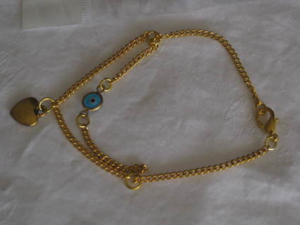 Gold tone bracelet with blue evil eye bead and gold heart charms.  1 bracelet !!!