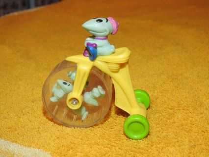 vintage monster on a toy bike, stamped by wheel but too small to see