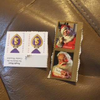 Four forever stamps unused