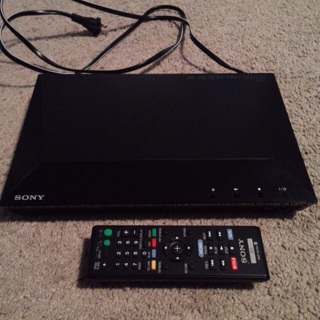 SONY BLU-RAY/DVD PLAYER: includes Remote and Indiana Jones DVD (HDMI cable not included)