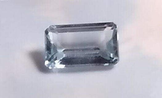 TOPAZ BLUE EMERALD CUT BIG 5.06 CARATS AND 8X13 MM AT A STEAL OF A DEAL PRICE.