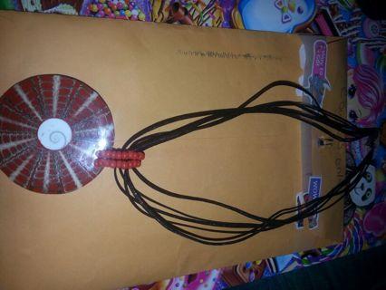 necklace round reddish pendent