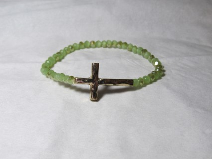 Golden Cross Stretch Bracelet with Green Gem Beads