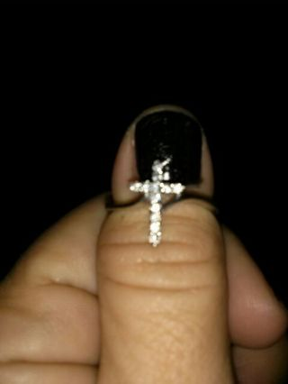A SOLID STERLING AND CZ CROSS RING SIZE 8